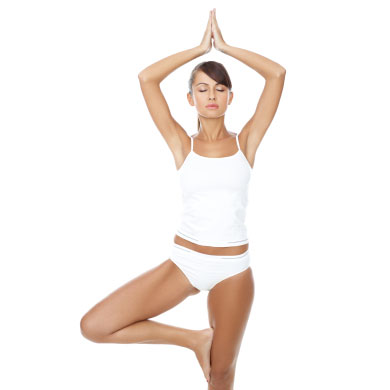 Young beautiful woman in yoga position on white